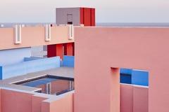 Geometric building swimming pool. Red wall, La manzanera. Calpe. Spain royalty free stock photo