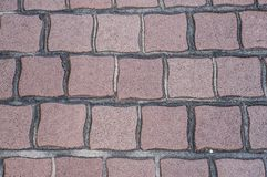 Geometric cobblestone in the street. Closeup of geometric cobblestone in the street stock photos