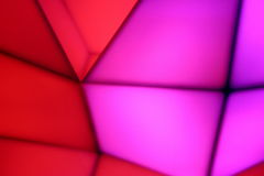 Geometric colorful abstract background. A colorful neon lights abstract background - pink and red colours Royalty Free Stock Images