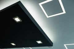 Geometric construction of celling maden with drywall and using modern economical LED light Stock Images
