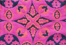 Geometric cotton woven pattern background. Kaleidoscope backdrop. Abstract ornament in black, red, and pink colors Stock Images
