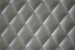 Geometric diamond pattern quilted PU leather royalty free stock photos