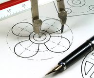 Geometric draw. Compass and pen drawing a circle royalty free stock photo