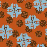 Geometric ethnic seamless vector pattern in brown and blue. royalty free illustration