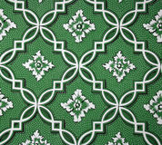 Geometric Floral Wallpaper. Beautiful green pattern with curved lines made into diagonal lines, flowers, diamonds, and polka dots Royalty Free Stock Photos
