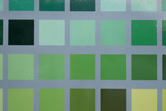 Geometric green colorful background with squares.  Stock Images