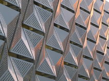Geometric metal cladding. With triangular futuristic modern design Royalty Free Stock Photos