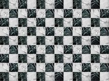 Geometric mosaic in the form of a chessboard made of marble stone stock photography