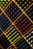 Wine by the Bottle. Geometric organizations of wine bottles with colorful wraps makes a pleasing piece for the eye Stock Photo