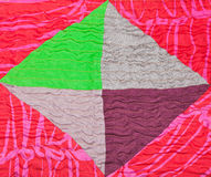 Geometric ornament of silk patchwork quilt. Close up Royalty Free Stock Photography