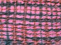 Geometric ornament on stitched batik cloth royalty free stock image