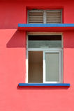Geometric pattern on colored architecture. A window and shadow on pink color wall, shown as geometric shape and color of the architecture Royalty Free Stock Photos