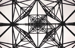Geometric pattern Electrical tower. Electric tower view below. The complex geometric pattern, Strict lines Royalty Free Stock Photography