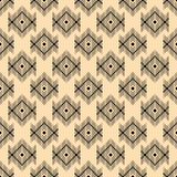 A geometric pattern of lozenges on a beige background.. Royalty Free Stock Photo