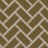 Geometric pattern with ornaments. Geometric pattern with white ornaments on brown Royalty Free Stock Photography
