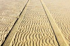 Geometric pattern on sand. Royalty Free Stock Image