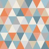Geometric pattern of triangles. Seamless. Warm and cold colors. Triangles are chaotically colored. Abstract background vector illustration