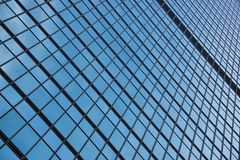 Geometric pattern of window frames on skyscraper Royalty Free Stock Images