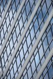 Geometric pattern of windows on glass facade Royalty Free Stock Photo