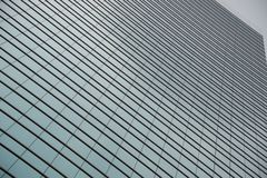 Geometric pattern of windows on glass skyscraper Royalty Free Stock Image