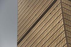 Geometric pattern of windows on gold skyscraper Royalty Free Stock Image