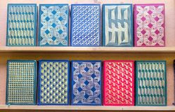 Geometric patterns embossed into the hard covers of books. In a used book store Stock Image