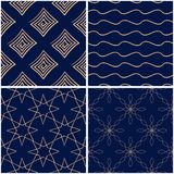 Geometric patterns. Set of golden blue seamless backgrounds. Vector illustration Royalty Free Stock Photography
