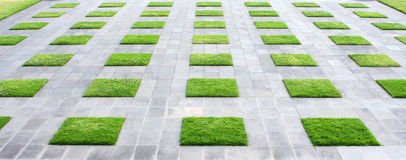 Geometric Paving. Stones and lawn squares, in panoramic crop Stock Images