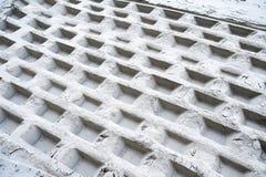 Geometric prints on a white sand Stock Photos