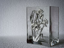 A geometric, rectangular patterned clear glass vase. Royalty Free Stock Photos
