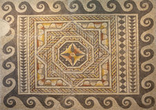 Geometric roman mosaic. Roman polychrome mosaic of Century VI AC with geometrical shapes Stock Photos