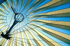 Geometric roof in front of blue sky royalty free stock photo