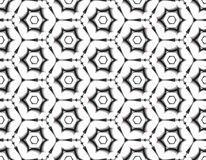 Geometric seamless  assembled from hexagons in a modern de. Contrast seamless illusion from black-and-white figures with petals of flowers on an abstract Royalty Free Stock Photography