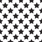 Geometric seamless pattern of black stars with glitter isolated. On white background. Stylish festive illustration Royalty Free Stock Photo