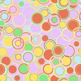 Geometric seamless pattern. The colorful multicolored circles and rings of different sizes, are located in a chaotic manner. Stock Photo