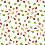 Geometric seamless pattern of green and red autumn  leaves. On a white background Stock Photos