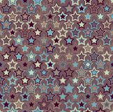 Geometric seamless pattern. Multicolored stars on a brown background. Stock Images