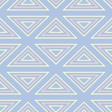 Geometric seamless pattern. Pale blue background with beige and pink elements. For wallpapers, textile and fabrics Royalty Free Stock Image