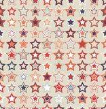 Geometric seamless pattern. The stars of different sizes and colors. The pattern elements are arranged on a light background. Useful as design element for Royalty Free Stock Photos