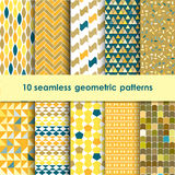 10 geometric seamless patterns set. Yellow, blue, brown and orange vector backgrounds collection stock illustration