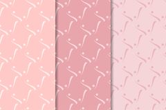 Geometric set of pale pink seamless patterns for design Stock Photography
