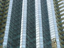 Geometric Shaped Glass Facade on Modern High Rise Building. Complex geometric 3d shapes on glass facade facade of modern high rise commercial building or office royalty free stock photos