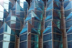 Geometric Shaped Glass Facade on Modern High Rise Building. Complex geometric 3d shapes on glass facade facade of modern high rise commercial building or office royalty free stock photography
