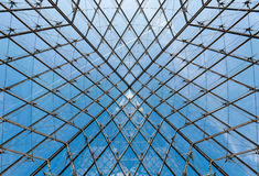Geometric Shapes in the ceiling of the Glass Pyramid at the Louvre Museum. Royalty Free Stock Photos