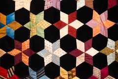 Geometric shapes and details on colorful fabric quilt