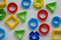 Geometric shapes in different colors, top view. Concept of creative, logical thinking or problem solving stock images
