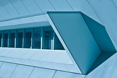 Geometric Shapes and Shadows. A view of a variety of abstract geometrical shapes created by modern building designs and shadows.  Image in blue tone Royalty Free Stock Photos