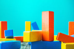 Geometric shapes on a wooden background. Colorful wooden blocks. Royalty Free Stock Image