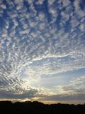 Geometric Sky at Sunrise. A sunrise in early 2018, Toronto, Ontario, Canada. A mix of Altocumulus, Cirrocumulus, and Stratus clouds creating a knit pattern Royalty Free Stock Images