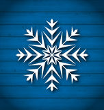 Geometric snowflake on wooden background Stock Photo